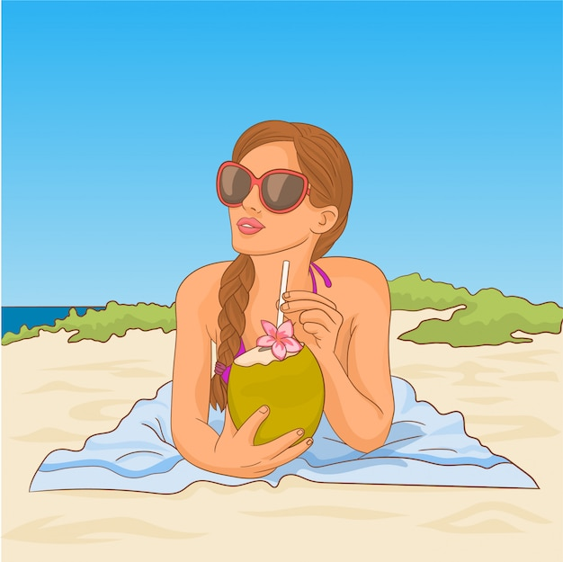 Woman in bikini with coconut on the beach