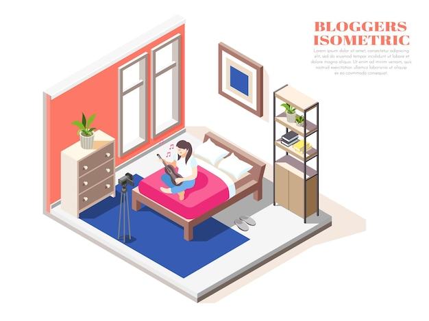 ベッドに座って、カメラの等角投影図の前でギターを弾く女性ブロガー