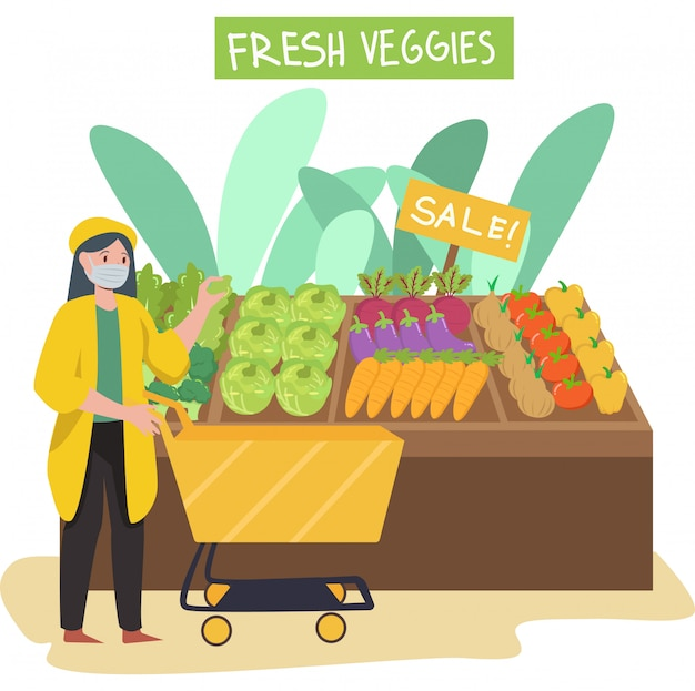 A woman buying fresh veggies at groceries shop while keep using medical mask
