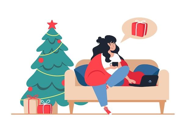 女性は自宅からクリスマスプレゼントのオンラインストア、新年のオンラインショッピングを購入します
