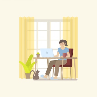 Woman in casual clothing working at home with laptop computer on table in cozy room