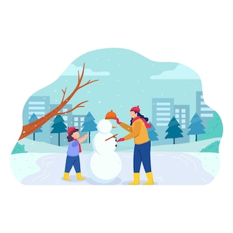 Woman and child doing winter activities in the park