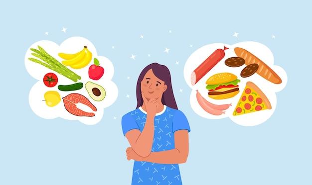 Женщина выбирает между здоровой и нездоровой пищей. сравнение фастфуда и сбалансированного меню