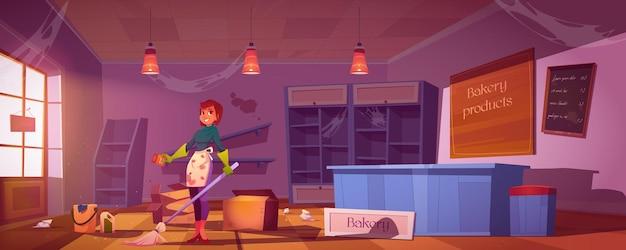 빈 선반, 엉망 및 쓰레기로 더러운 빵집 가게를 청소하는 여자