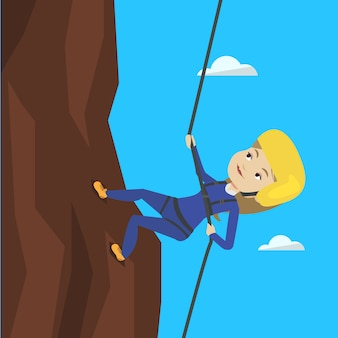 Woman climbing in mountains with rope.