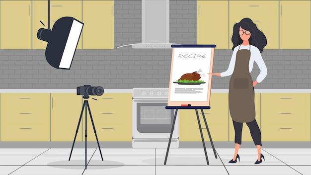 주방에서 일하는 여성 요리사는 계속해서 요리 브이로그를 이끌고 있습니다. 주방 앞치마를 입은 소녀가 프라이드 치킨을 들고 있습니다. 벡터.