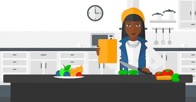 Женщина готовит еду.