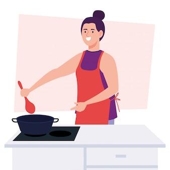 ストーブ付きエプロンを使用して料理をする女性、キッチン用品