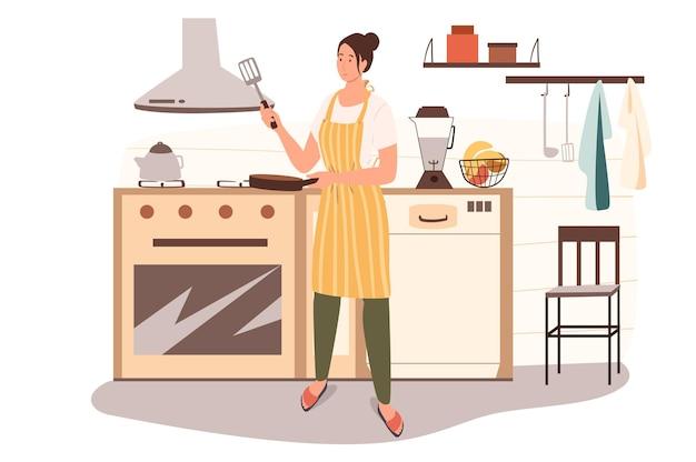 여자는 가정 부엌 웹 개념에서 요리. 앞치마의 주부는 아침 식사를 준비하고, 프라이팬에 팬케이크를 굽고, 수제 요리