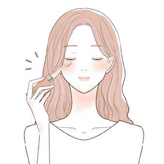 ホットビューラーでまつ毛をカールする女性。白い背景に。