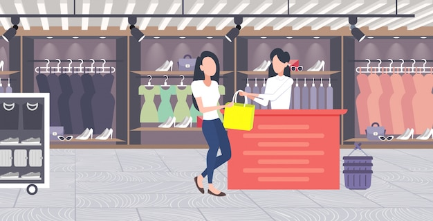 Woman customer buying new handbag at cash desk counter fashion shop cloth store female shopping mall modern boutique interior  horizontal