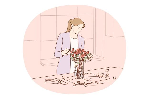 가위로 절단하고 신선한 장미 꽃다발을 퍼팅하는 여자