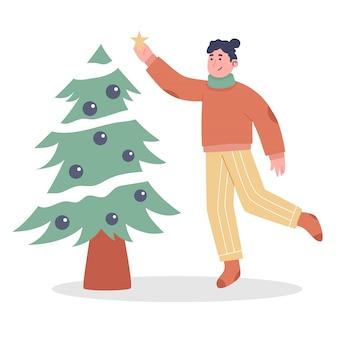 ツリークリスマスの女性の装飾