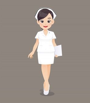 Woman doctor or nurse in white uniform holding a clipboard