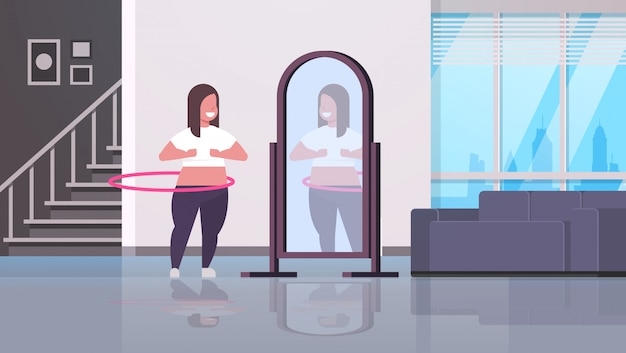 Woman doing gymnastic rotating workout with hula hoop looking at reflection in mirror girl weight