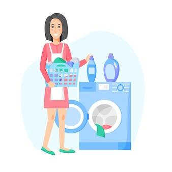 洗濯をしている女性。洗濯機と洗濯かご、衣類と洗剤。