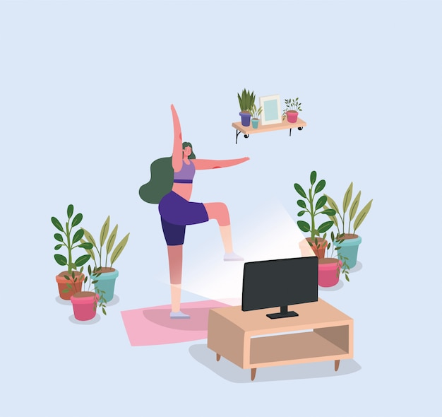 Woman doing yoga on mat in front of tv at home  design