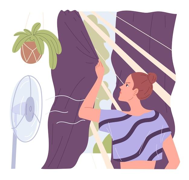 여자는 여름 더위에 집에서 매우 더운 커튼을 그립니다.