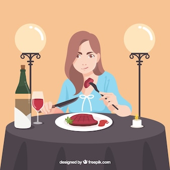 Woman eating a steak in elegant restaurant