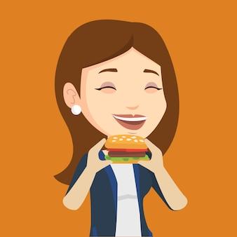 Woman eating hamburger  .