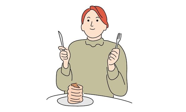 朝食にパンケーキを食べる女性