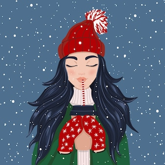 一杯のコーヒーと雪が降るのを楽しんでいる女性