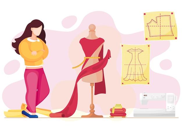 Женщина рассматривает манекен с красной тканью для будущего платья.