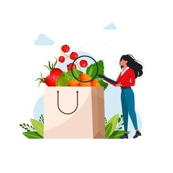 Женщина рассматривает в лупу ягоды, богатые витамином с, бумажный пакет со свежими ягодами фруктов. векторная иллюстрация для концепции органического питания, диетолог, веган или вегетарианец
