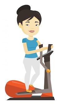 Женщина, упражнения на эллиптический тренажер.