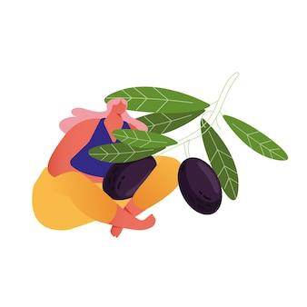 Женщина-фермер держит ветку со спелыми оливками. сбор урожая в саду.