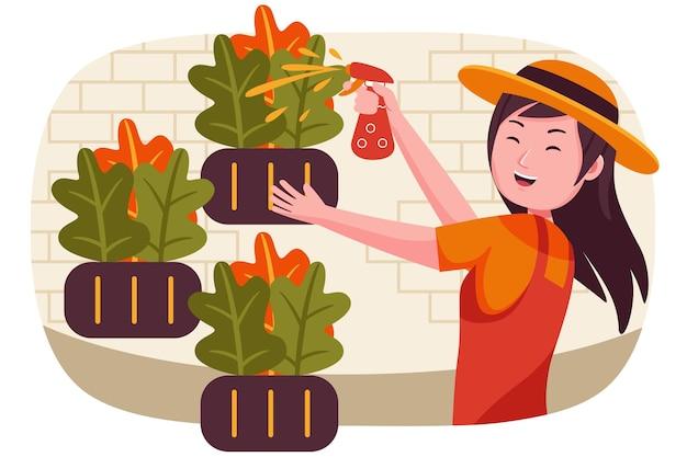 Женщина-фермер распыления пестицидов на ферме.