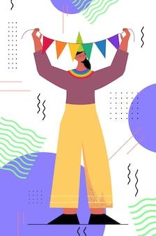 Woman in festive hat celebrating transgender love parade lgbt community concept vertical