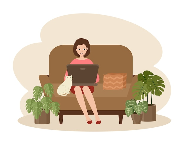 Woman freelancer with a laptop sitting on a sofa