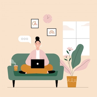 Woman freelancer working on laptop at home.