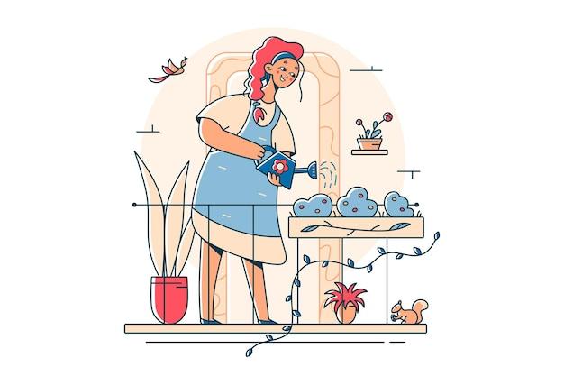 Женщина-садовник поливает садовые цветы