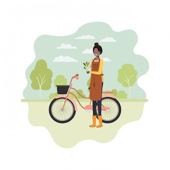 Woman gardener with landscape and bicycle