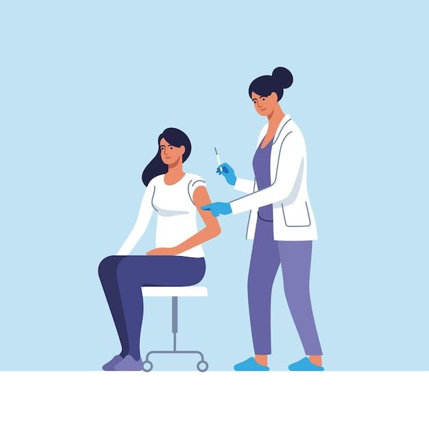 Женщине делают прививку от коронавируса в больнице