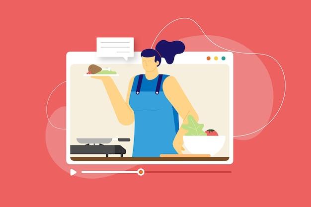 女性は料理のオンラインコースのビデオを与える