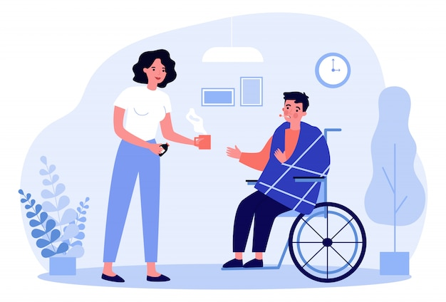車椅子の病人に薬を与える女性