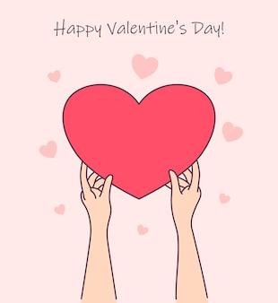 Женщина рука держит подарочную коробку красного сердца.