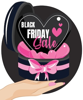 Woman hands holding gift box with pink bow over black friday sale background