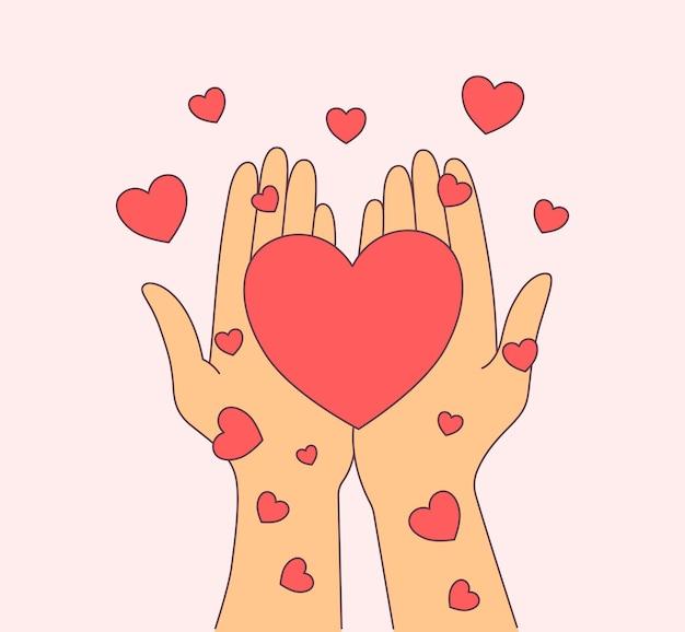 Руки женщины держа красные сердца.