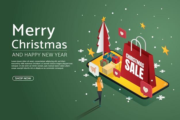 スマートフォンで女性の幸せなショッピングオンライン紙袋ギフトボックスメリークリスマスと新年あけましておめでとうございます