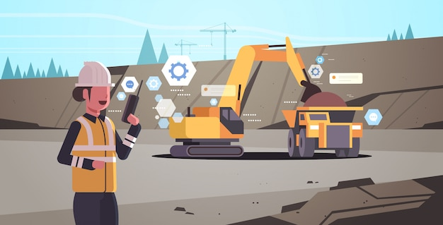 Woman in helmet using walkie talkie controlling excavator