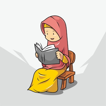 A woman in hijab is reading a book