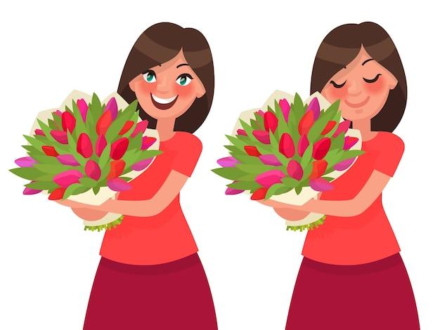 꽃의 꽃다발을 들고 그 향기를 흡입하는 여자.