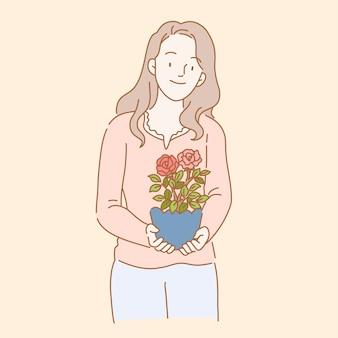 線のスタイルでバラの植物を保持している女性
