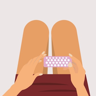 Woman holding contraceptive pills in the bed room