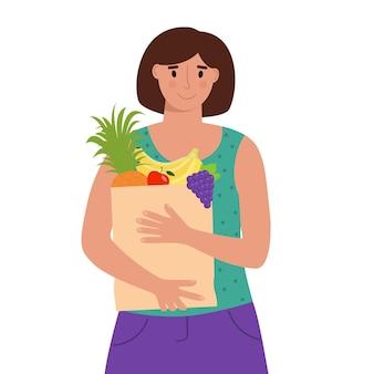 과일과 함께 식료품 종이 봉지를 들고 있는 여성 건강한 식생활 채식 생활 방식 개념