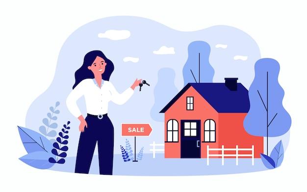 여자가 판매를위한 집에서 키를 들고 웃 고